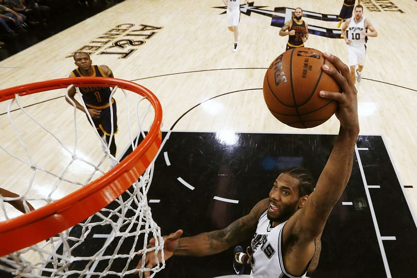 Spurs forward Kawhi Leonard going up for an easy basket in their 103-74 drubbing of the Cavaliers at the AT&T Centre in San Antonio, Texas. He top-scored with 25 points and left to a standing ovation as his team enjoyed their fifth straight win.