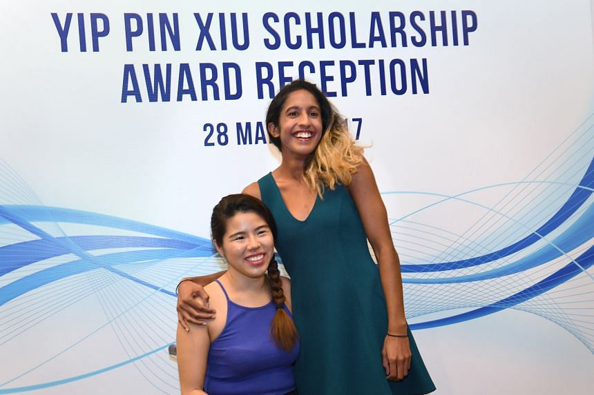 National sprinter Shanti Pereira poses with Yip Pin Xiu at a reception yesterday, when she was awarded a Singapore Management University scholarship that bears the three-time Paralympic champion's name.