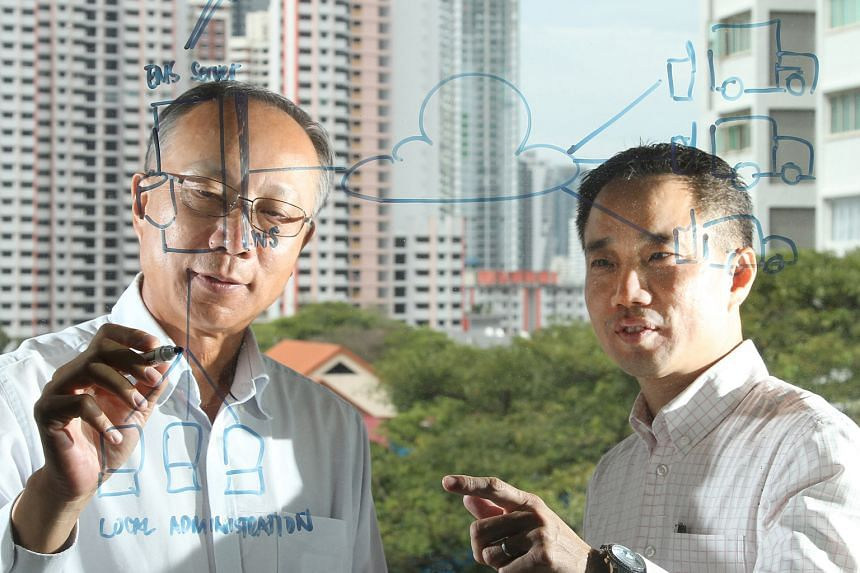 Mr Seah (right), Enhanzcom's CEO, with SIMTech's senior scientist Dr Song. Enhanzcom helps SMEs digitise their workflow using Fitprise, a Web-based software solutions developed by SIMTech.