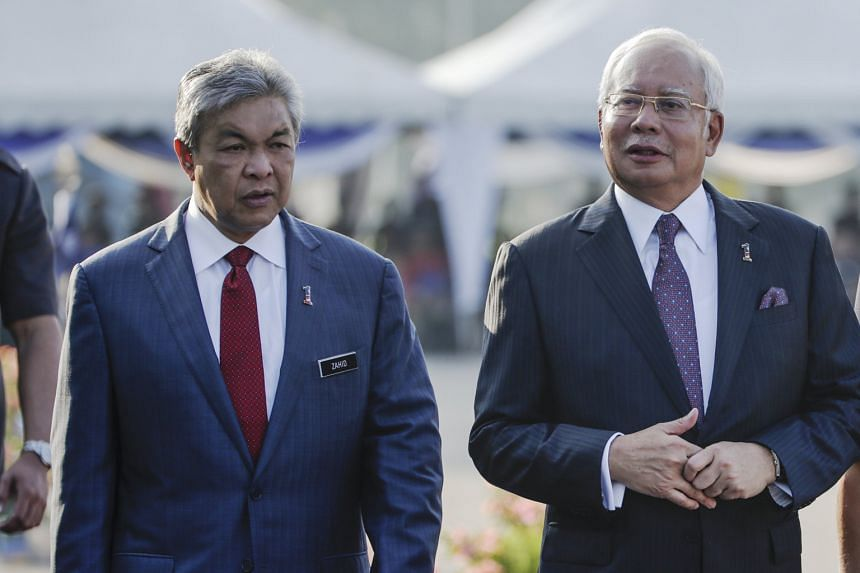 Mr Najib Razak and his deputy Zahid Hamidi (far left) at the 210th Police Day celebrations in Kuala Lumpur last Saturday. Netizens have pointed out a possible tension between the two leaders, given their conflicting statements over suggested amendmen