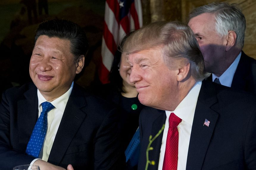 Mr Donald Trump and Mr Xi Jinping shook hands and smiled broadly for the cameras during a dinner at the Mar-a-Lago resort in Florida on Thursday.