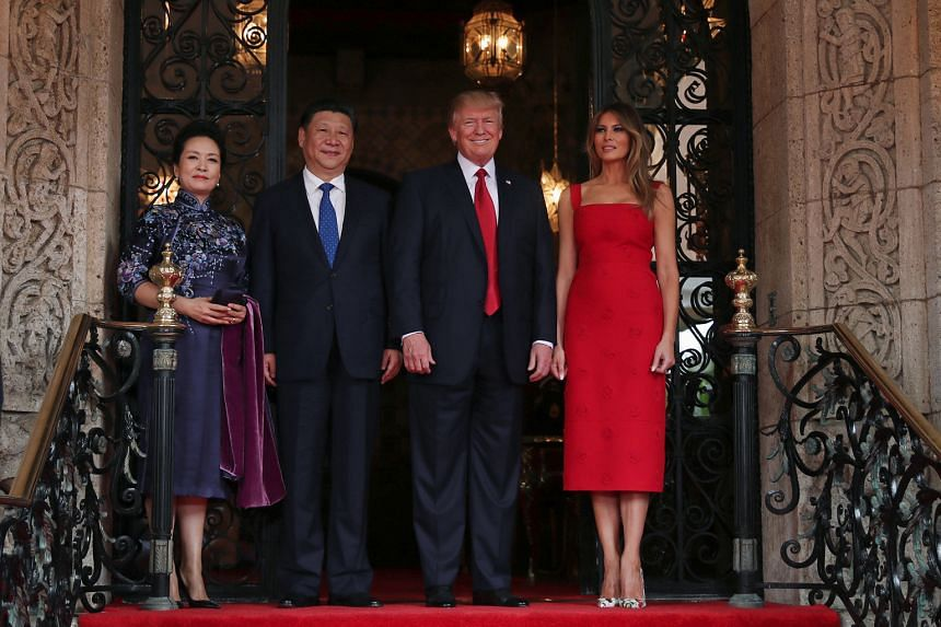 US President Donald Trump and First Lady Melania Trump with Chinese President Xi Jinping and First Lady Peng Liyuan at the Mar-a-Lago estate in Palm Beach, Florida, on Thursday.