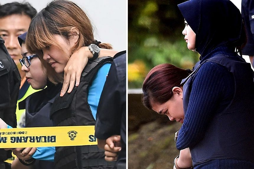 Vietnamese national Doan Thi Huong (left) and Indonesian national Siti Aisyah (right) being escorted by Malaysian police after a court appearance in Sepang yesterday. Lawyers for the two have complained that they had scant access to their clients.