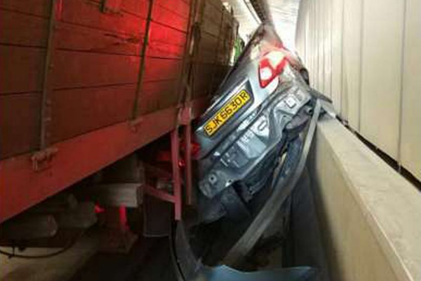 A driver escaped with minor injuries when his car was crushed by a trailer in an underpass in Tuas yesterday afternoon. The 45-year-old man was taken to Ng Teng Fong General Hospital, said police. He is understood to have suffered some cuts. The poli