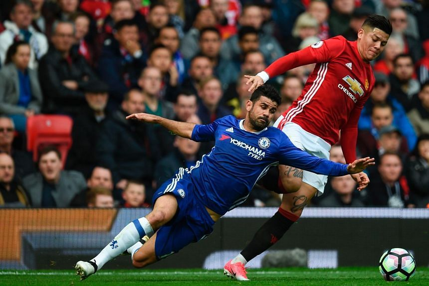 Diego Costa playing through illness at Old Trafford as Manchester United defender Marcos Rojo contains the Chelsea striker.