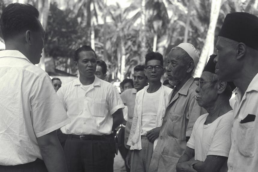 Mr Othman touring the Mountbatten area - where he met leaders of the goodwill committee - as part of efforts to restore racial harmony after the July 1964 racial riots. Above: Minister for Social Affairs Othman Wok accompanying Prime Minister Lee Kua