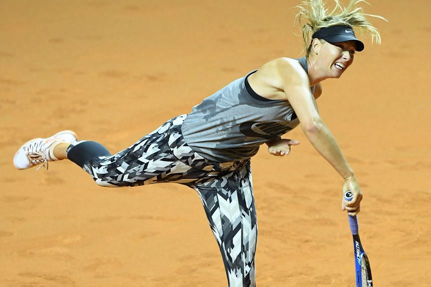 Maria Sharapova serving during a training session on the clay courts of Stuttgart ahead of her controversial return to competitive tennis after a doping ban. The Russian has met with disapproval for being allowed to make her anticipated return here.