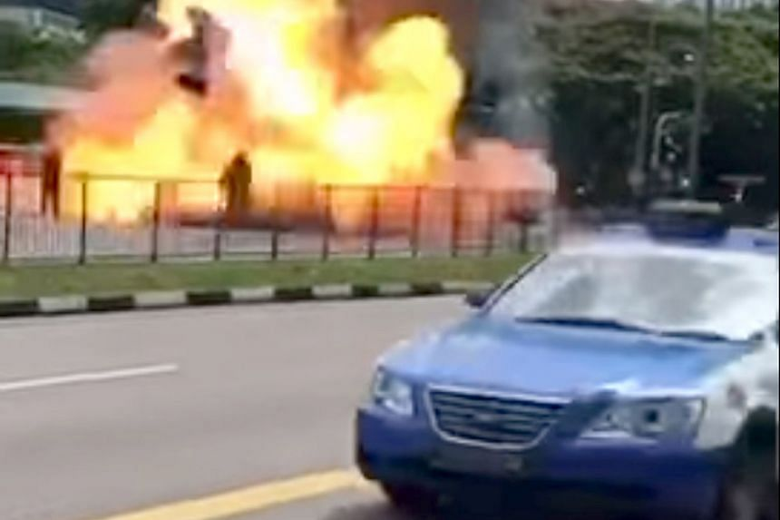 Screenshots from a video of the incident in Commonwealth Avenue showing the burning Trans-Cab taxi, which explodes and engulfs a fireman in flames. Preliminary investigations revealed that a road accident likely caused the blast.