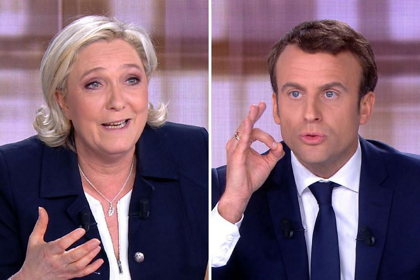 "Ms Marine Le Pen branded Mr Emmanuel Macron ""the candidate of the elite"", while he described her as ""the heir of a system which has prospered from the fury of the French people for decades"". They also clashed repeatedly over terrorism, the economy an"