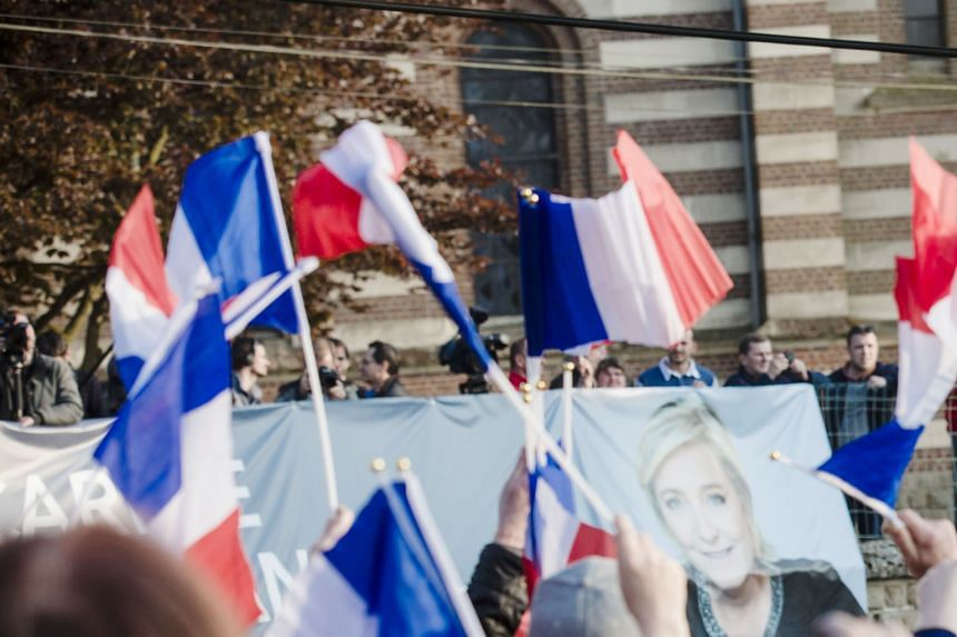 French presidential candidate Marine Le Pen speaking during an election campaign event in Ennemain on Thursday. The first-round victory of the leader of France's far-right National Front reminded the writer of his father, who would vote for Ms Le Pen