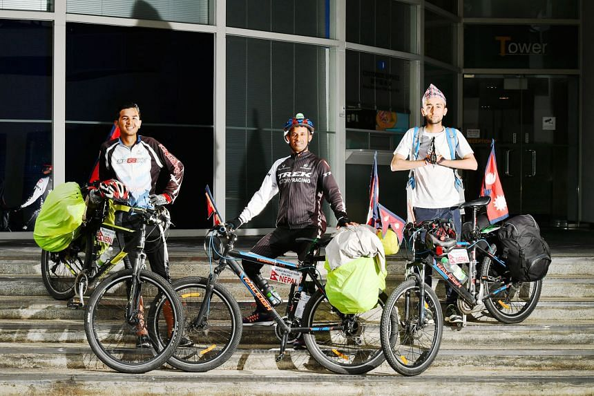 (From left) Mr Dilip Chhetri, Mr Nirmal Baral and Mr Anish Dhakal are cycling around the world to promote peace and spread awareness of environmental issues. Singapore is their 11th country since they left Nepal last December. So far, they have trave