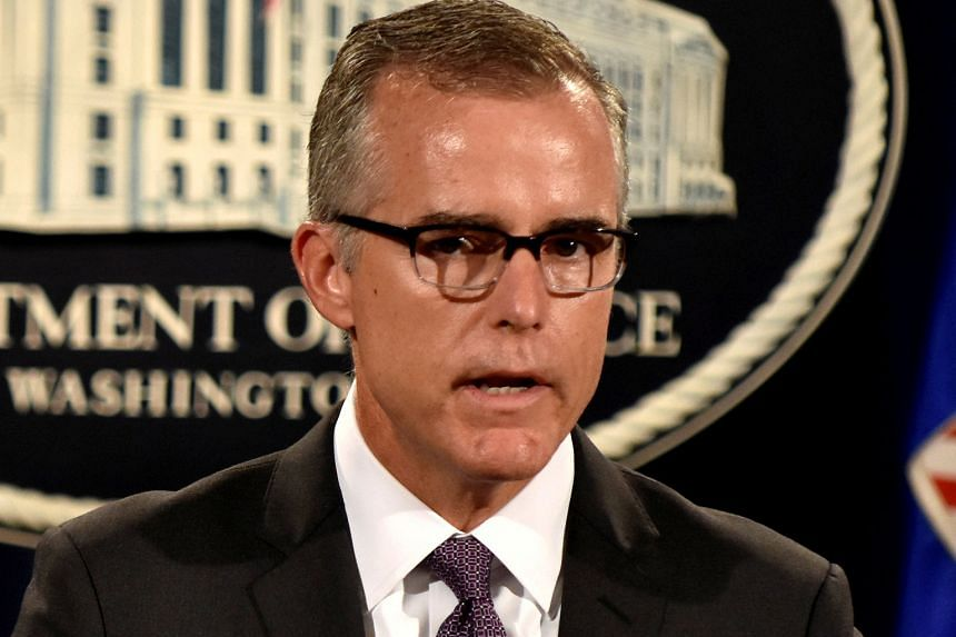 FBI acting director Andrew McCabe said his agency would continue looking into possible Russian links. Protesters denouncing the firing of FBI director James Comey by US President Donald Trump, on Wednesday in Los Angeles. Mr Trump lashed out at oppos