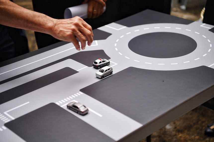 A re-created table-top map with toy cars showing how driving theory tests were held at the former Traffic Police headquarters.