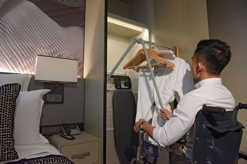 A user-friendly wardrobe for wheelchair users at the Ascott Orchard (above) serviced residence, which is part of CapitaLand's integrated development in Cairnhill.
