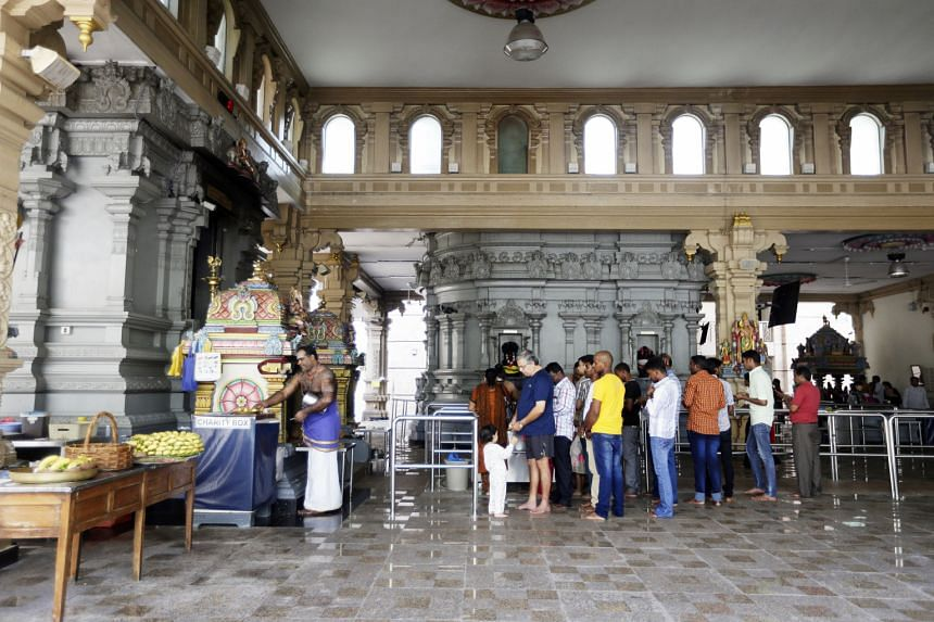 Mr Chandra Mohan Kottasamy and Ms Nanthakumahie Gunasegaran held a traditional wedding at the temple in 2015, with a guest list of over a thousand. Baby Arian Vel Gerard getting his head shaved as part of tonsure. Providing for the ritual is one of t