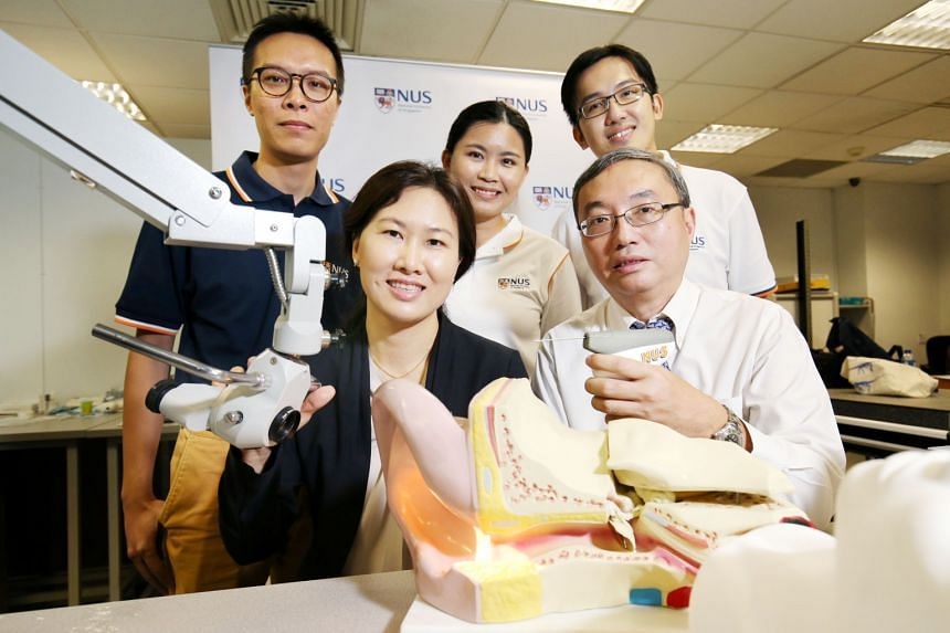 The research team behind CLiKX is made up of (from right) Dr Liang Wen Yu, Dr Lynne Lim, Ms Ng Cailin, Associate Professor Tan Kok Kiong (holding the device) and Mr Gan Chee Wee. CLiKX allows for the procedure to be done in a ward or clinic and needs