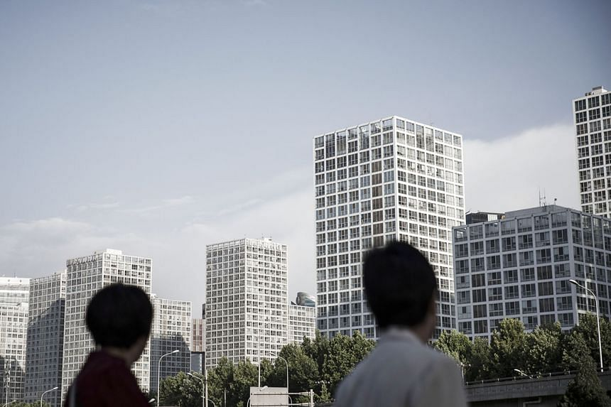 Jianwai Soho, a mixed-use residential and commercial complex, in Beijing, China. In the first quarter this year, 88 per cent of investments in residential sites from Singapore flowed into China, 2 per cent higher than last year's figure, according to
