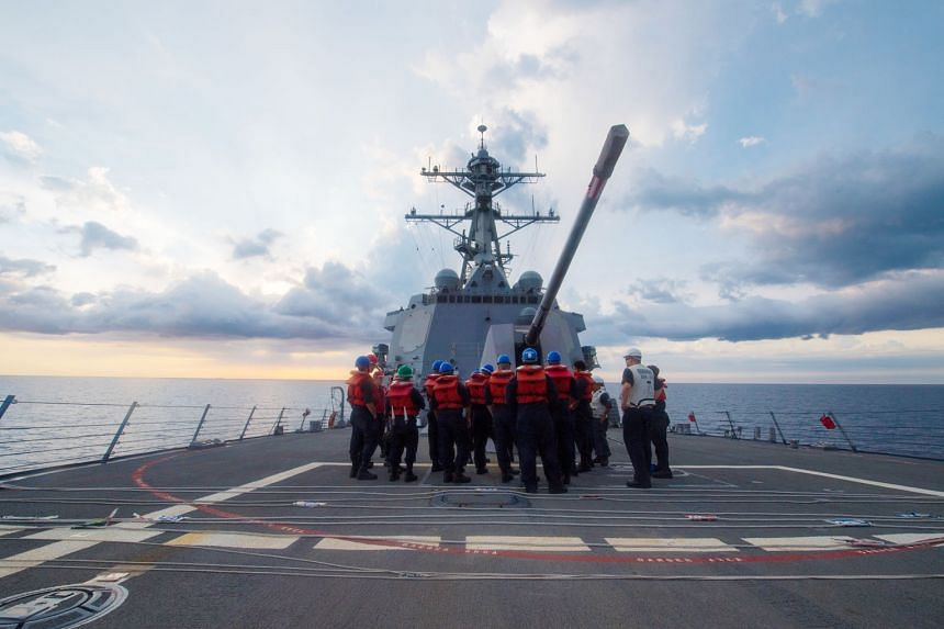 """The USS Dewey in the South China Sea last month. A US official said the USS Dewey last week """"engaged in normal operations by conducting a manoeuvring drill inside 12 nautical miles of Mischief Reef""""."""