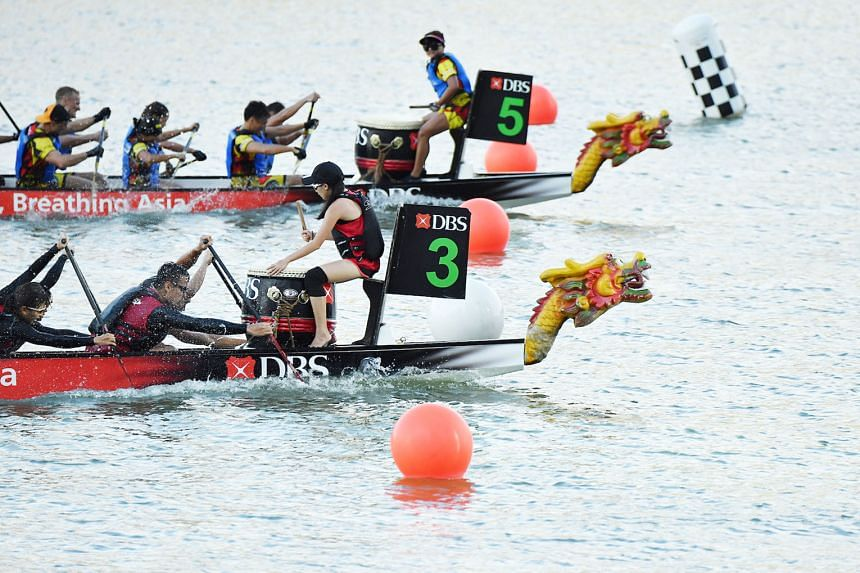 The DBS Asia Dragons (2min 36.742sec), in the No. 3 boat, edging out Hong Kong Disneyland Team Mushu Gold (2:36:768) to win the DBS Marina Regatta corporate mixed 12-crew 500m final at Marina Bay's The Promontory yesterday. The other winners were Sin