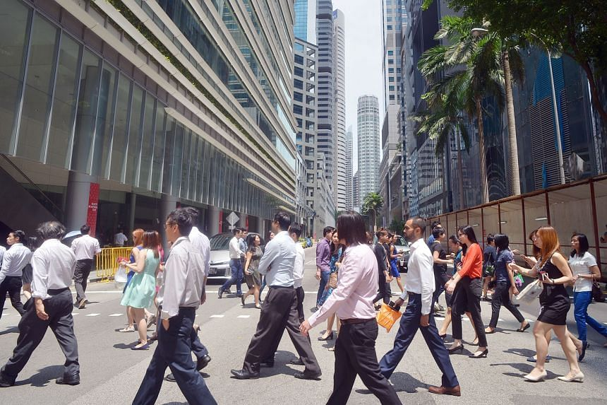The office crowd in the Central Business District. Singapore is losing its economic competitiveness and a slowdown in productivity is at the core of its stagnating economic growth, says the writer.