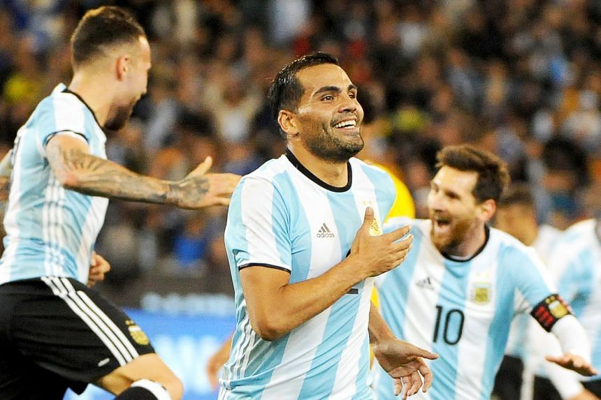Top: Sevilla defender Gabriel Mercado (centre) celebrating with his Argentina team-mates after scoring the only goal of the match on the stroke of half-time against Brazil in front of 95,569 fans at the Melbourne Cricket Ground. Right: Manchester Cit