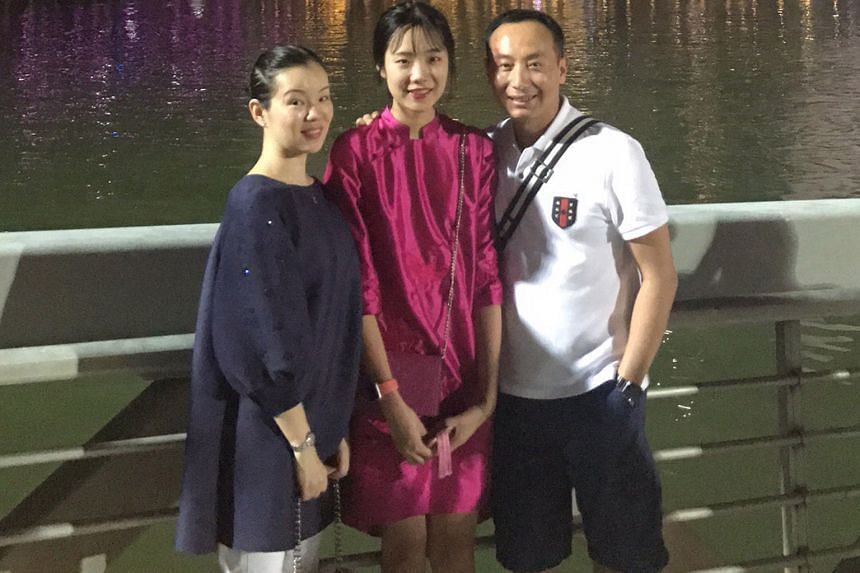Mr Zhang Yitian with his wife Cheng Qi and daughter Jiasi during a trip to Singapore earlier this year. The Zhangs, from China's northern Hebei province, were changing a large sum when they were given an extra $13,400 by a Chinatown money changer a w