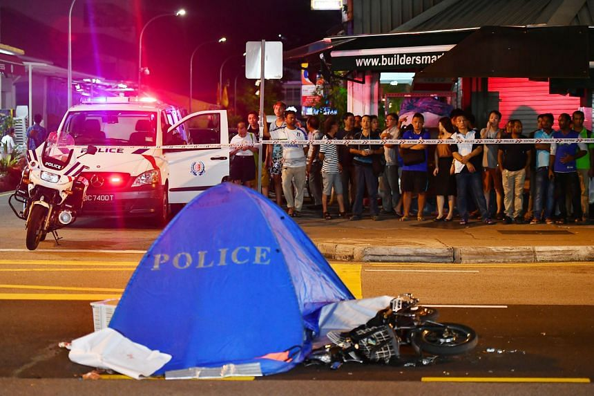 The scene at the junction of Lorong 13 Geylang and Sims Avenue where an e-bike rider died after an accident with a prime mover last night. It is believed that the victim was a worker at a coffee-shop food stall.