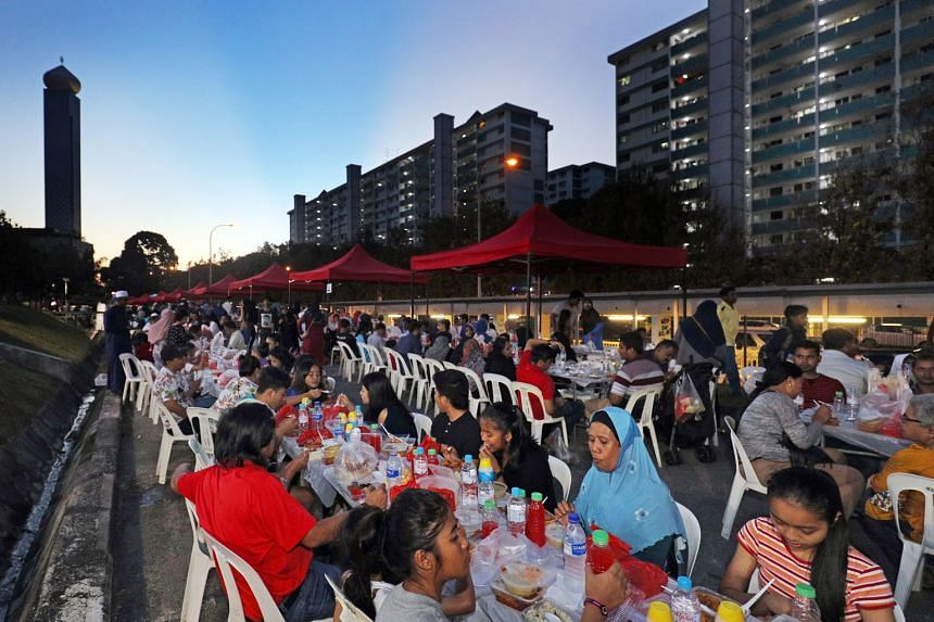 About 4,000 residents breaking fast together at a special event at Marsiling Mega Sports Park on June 4.