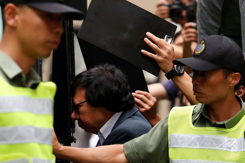 Tycoon Thomas Kwok getting into a prison van outside Hong Kong's Court of Final Appeal yesterday after his graft conviction was upheld.