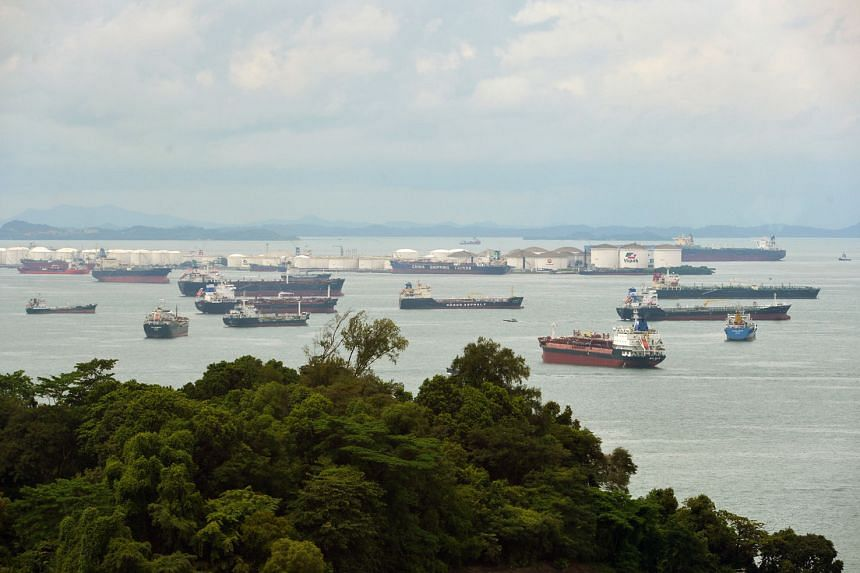 Oil tankers in front of Pulau Sebarok, an oil storage and refuelling port among the southern islands of Singapore. Brokers say around 10 VLCCs have been chartered since the end of last month to store crude for periods ranging from 30 days to around s