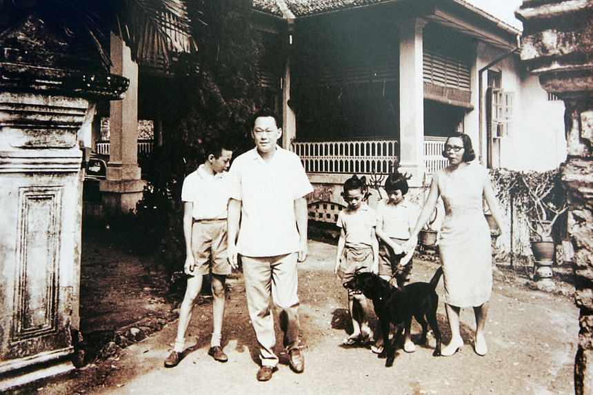 Mr and Mrs Lee Kuan Yew at their home in Oxley Road with their three children (from left) Hsien Loong, Hsien Yang and Wei Ling.