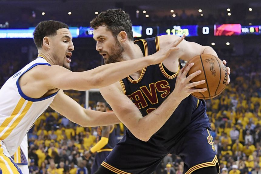Cleveland Cavaliers forward Kevin Love is guarded by Golden State Warriors' Klay Thompson during the recent NBA Finals. The Cavs are likely to look at the possibility of trading Love.