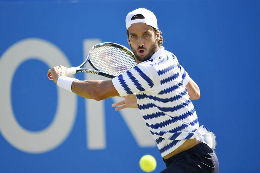 Spain's Feliciano Lopez returning against Stan Wawrinka of Switzerland in their first-round match at the Queen's Club. The world No. 3's Wimbledon preparations suffered a blow after being dumped out, with world No. 6 Milos Raonic joining him