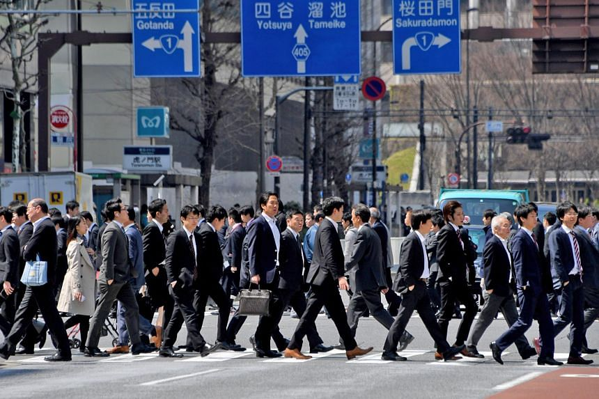 Japanese salarymen on the move in Tokyo. According to a survey, the percentage of children who said they respected their mothers surged to a record high of 68.1 per cent, surpassing for the first time the proportion - 62 per cent - who said they resp