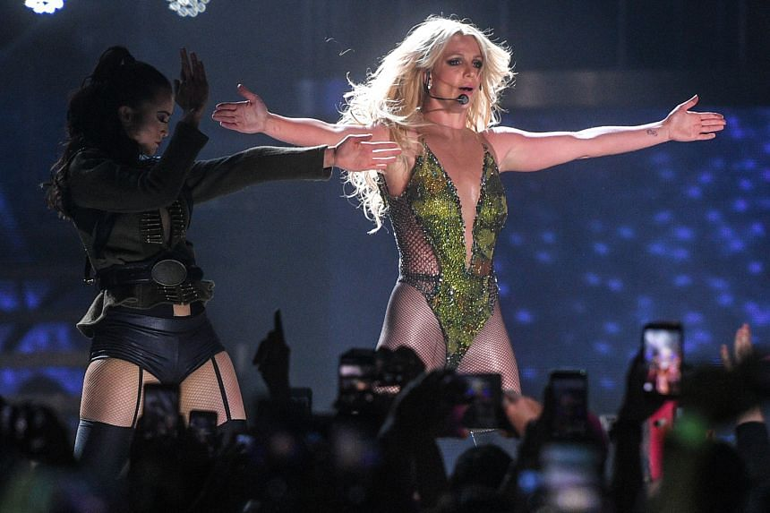 Pop singer Britney Spears entertained the crowd with her many outfit changes and spectacular sets at her first full-length concert here.
