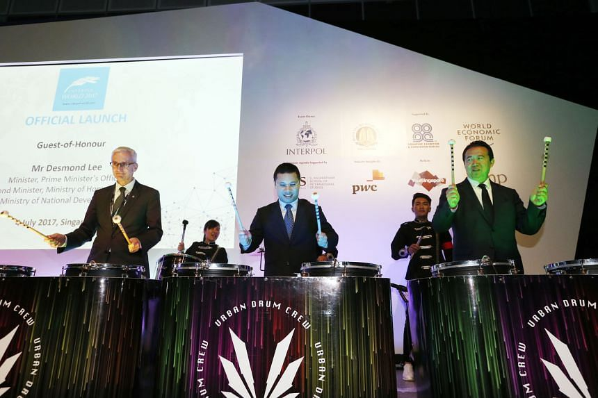 Second Minister for Home Affairs Desmond Lee (centre) playing the drums with Interpol secretary- general Jurgen Stock (left) and Interpol president Meng Hongwei at the opening of Interpol World 2017 yesterday.