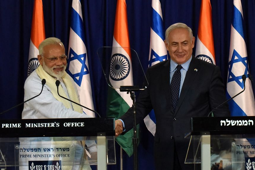 Indian Prime Minister Narendra Modi with his Israeli counterpart Benjamin Netanyahu in Jerusalem on Tuesday. Mr Modi has been accorded a warm welcome in Israel, which is keen to woo the economic powerhouse.