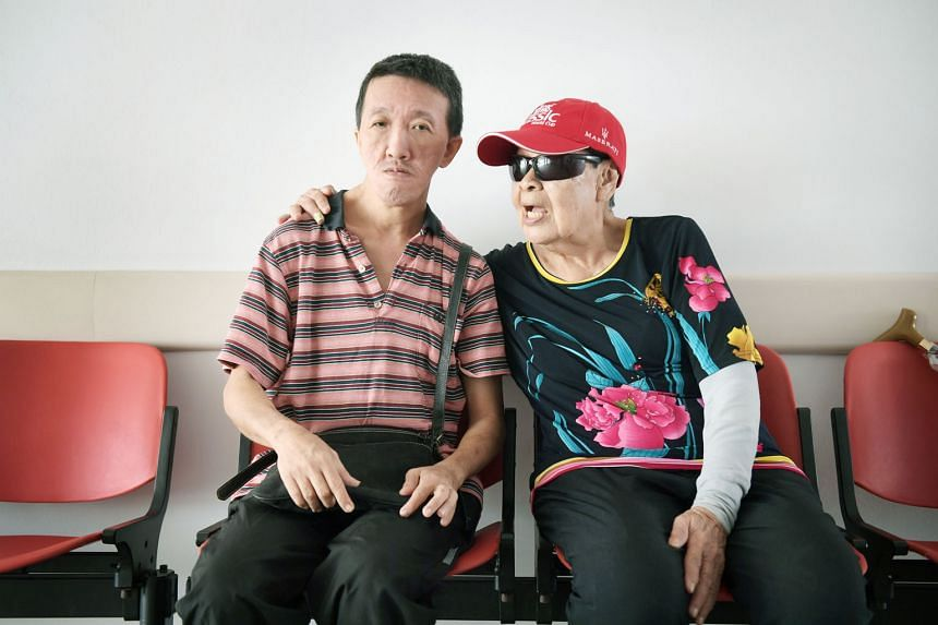 Madam Ng Ah Chun, 89, single-handedly raised Mr Tan Chye Teck, 50, after he was abandoned by his parents as a baby. He was diagnosed with moderate intellectual disability as a child but that did not deter her from looking after him, even though it wa