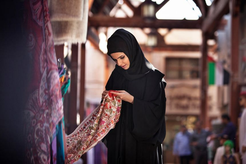 Shop for gorgeous fabric at one of the many traditional markets known as souqs. PHOTO: TOURISM DUBAI