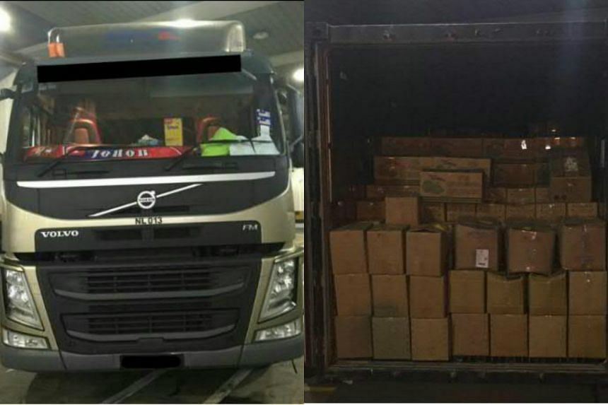 The truck (left) and the boxes of vegetables used in the commission of the offence.