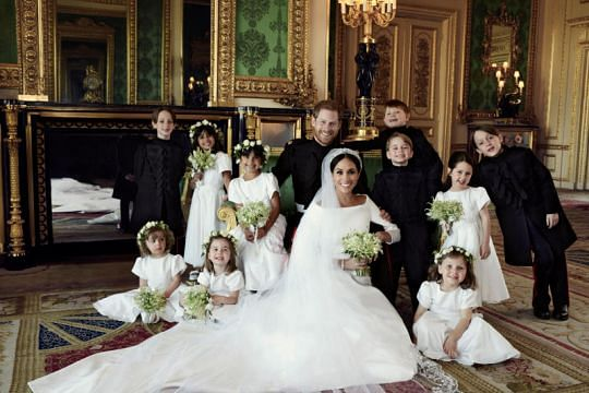 Britain's Prince Harry and Meghan Markle release official photos of their royal wedding