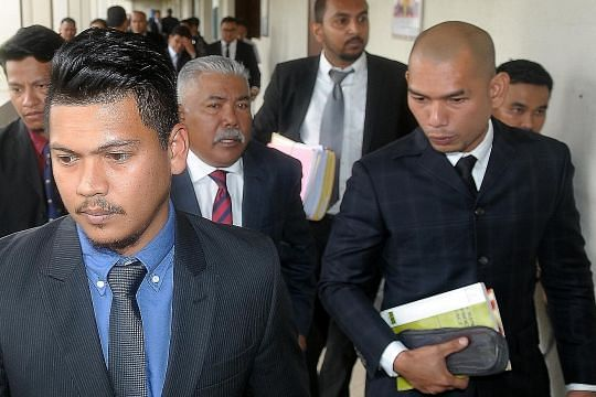 Malaysian ex official, son jailed for graft over solar projects