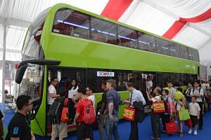 People getting a look at the new green bus at the Bus Carnival at Ngee Ann Civic Plaza on March 11, 2016.