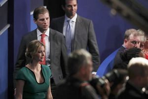 Republican President-elect Donald Trump's children Ivana, Eric and Donald Jr. arrive at the start of the second US presidential town hall debate at Washington University in St. Louis.