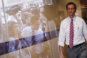 Former US congressman from New York and current Democratic candidate for New York City Mayor Anthony Weiner leaves a campaign stop at the Nan Shan Senior Center to meet the press, in the Queens borough of New York on July 29, 2013. A majority of New