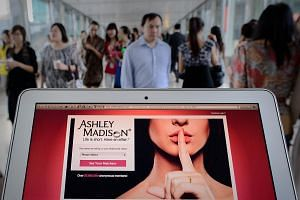 The homepage of the Ashley Madison dating website is displayed on a laptop in Hong Kong on Aug 20, 2013. The Media Development Authority of Singapore (MDA) has banned extra-marital dating website Ashley Madison, deeming its content objectionable