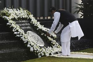 Maharashtra's Chief Minister Prithviraj Chavan places a wreath as he pays tribute at the Gymkhana police memorial marking the November 2008 Mumbai attacks, in Mumbai on Tuesday, Nov 26, 2013. India on Tuesday marked the fifth anniversary of mili