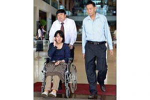 Thai teenager Nitcharee Peneakchanasak, who fell onto the tracks of Ang Mo Kio MRT station in 2011 and lost her legs,at the High Court on Oct 29, 2012. With her is her father, Mr Kittanesh Peneakchanasak (right), and Mr Christopher Bek from the