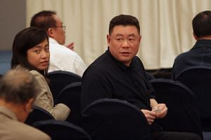 Hong Kong tycoon Joseph Lau (second from right) with his assistant Chan Hoi Wan at a Sotheby's auction in Hong Kong in 2005.Lau, the head of Chinese Estates Holdings, was found guilty of bribery and money laundering in a land deal in Asia's gam