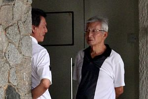 Mr Roy Gan, brother of Ms Nancy Gan, on the left in white. Family and close friends on Saturday attended the wake of socialite and philanthropist Nancy Gan, who was found dead in the swimming pool of her Bukit Timah bungalow on Wednesday, March 19, 2